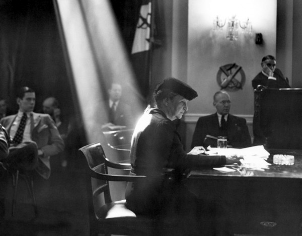 Francis Perkins signing to become Secretary for Labour. She is illuminated by a shaft of sunlight.