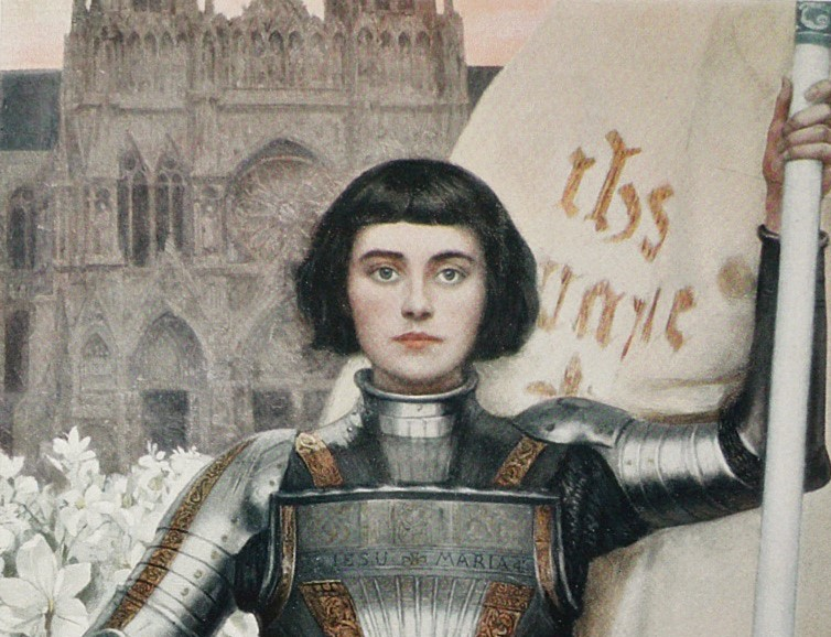 1903 painting of Jeanne d'Arc. She is in armour in front of a cathedral and surrounded by white flowers
